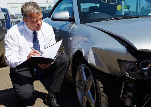Loss Adjuster Inspecting A Car