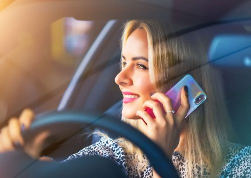 Woman Using Phone While Driving